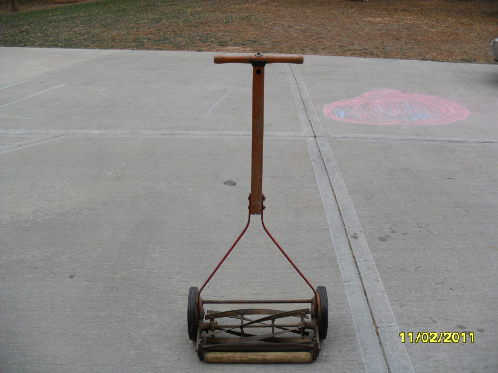 Old fashioned grass cutter